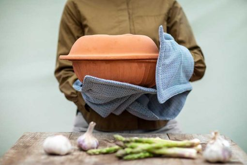 woman using organic cotton oven gloves