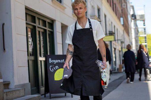 man walking down the street in an organic cotton apron