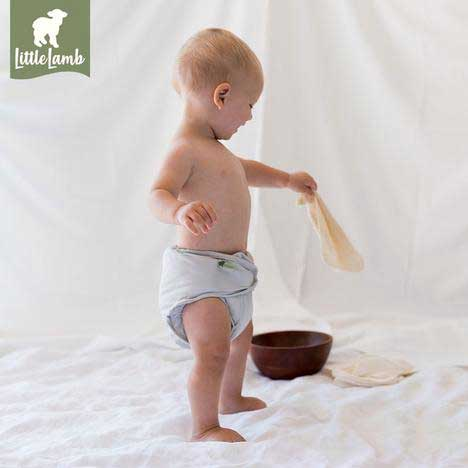 baby holding a reusable baby wipe
