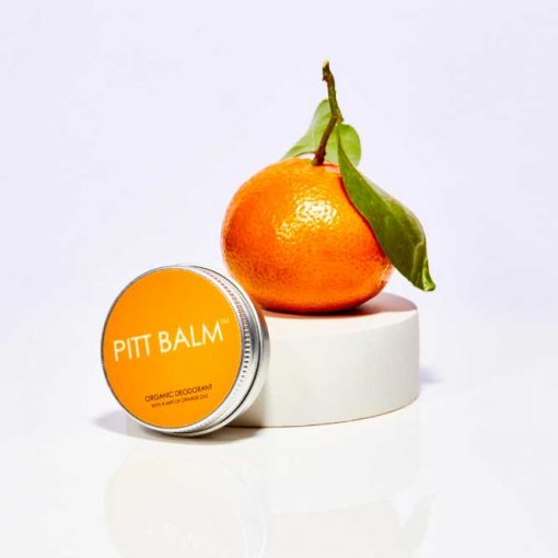 pitt balm natural deodorant next to an orange