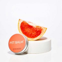 pitt balm natural deodorant next to a grapefruit