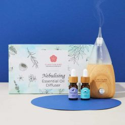 nebuslising aromatherapy oil diffuser on blue background