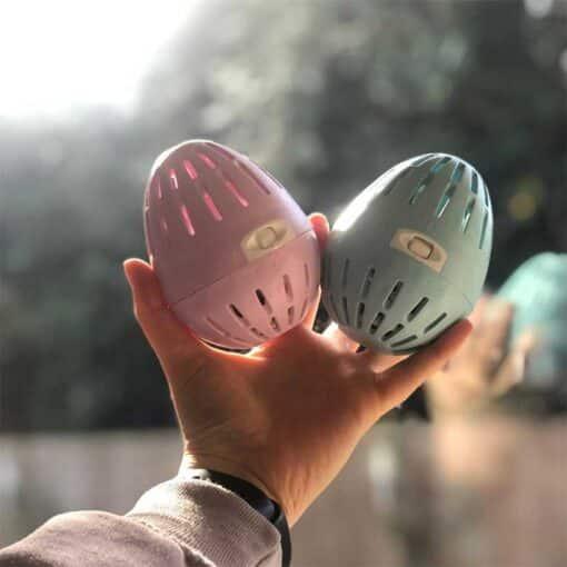 woman holding two ecoegg laundry eggs