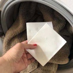 laundry detergent sheets going into washing machine