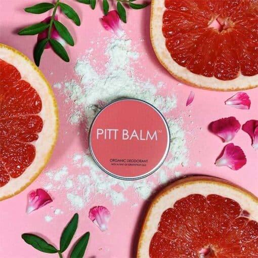 pitt balm natural deodorant next to grapefruits