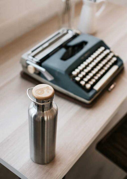 bambaw insulated water bottle next to typewriter