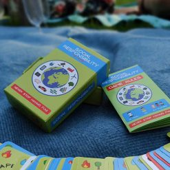 social responsibility card game on a blanket being played