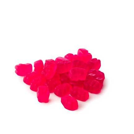 pile of vegan gummy multivitamins on white background