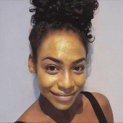 woman using evolve bio retinol gold face mask