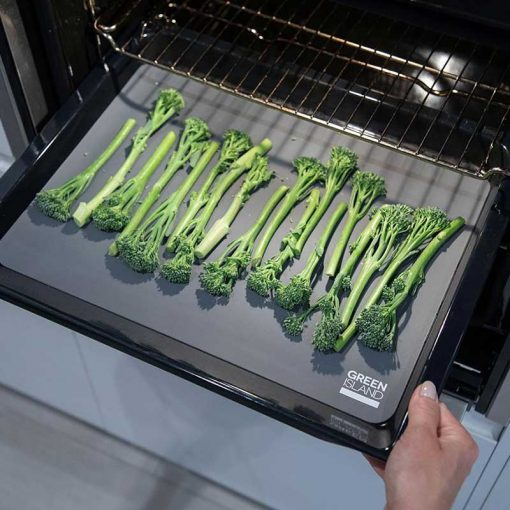 reusable silicone baking mat with broccoli on top