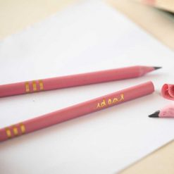 recycled pink pencils on a piece of paper