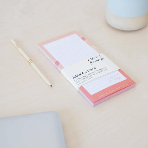 pink recycled paper list pad on kitchen side