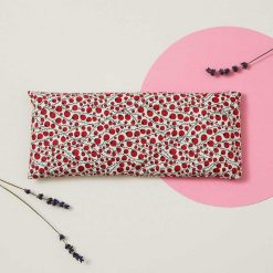 eye pillow with red berries printed on it